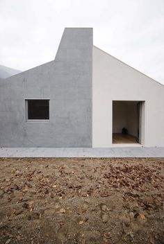 Wigglyhouse is a minimal home located in Como, Italy, designed by ifdesign. Canadian gray granite covers the entire building to symbolize this idea of protection with the exception of the walls where the volume is subtracted by the grey-plaster made patios.