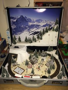 suitcase train layout ..Oh how much fun would this be!
