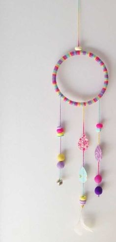 Wall hanging that will look cute in any room or nursery. Hand wrapped 5 inch hoop with a mixture of felt balls, clay beads, fabric drops, a bell, a. Owl Crafts, Diy And Crafts, Craft Projects, Crafts For Kids, Arts And Crafts, Craft Ideas, Creation Deco, Felt Ball, Wooden Crafts