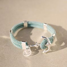 Nautical, sterling silver anchor bracelet, waterproof seafoam/mint cord - New Haven Bracelet. $142.00, via Etsy.