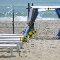 Espresso Arbor, burlap, white and navy fabrics, accented with sunflowers.