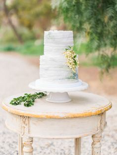 Ruffled wedding cake with hints of blue: http://www.stylemepretty.com/2016/05/25/the-ultimate-something-blue-wedding-inspiration/ | Photography: The Grovers - http://www.troygrover.com/