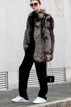 All black with a fur, white sneakers, and mini YSL.