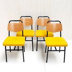 Suite de quatre chaises de Raphaël années 50, disponible sur Kolectiv Design