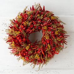 """Hand-crafted from an abundance of dried peppers and blooms, this eye-catching wreath brings the vegetable patch indoors throughout the seasons.- Thai peppers, Sweet Annie artemisia, golden tansy, red gomphrena- Indoor use only- Handmade in the USA3.5""""D, 12"""" diameter"""