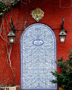 How beautiful is this colour combination.  Elaborated print on the door.  NYC West Village painted door