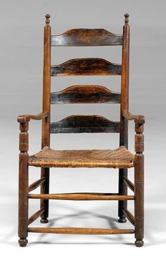 Early Virginia armchair,    slat back with turned finials and arm supports, hickory and other mixed woods with oak split seat, turned feet, traces of early dark finish, attributed to Virginia, 18th century, 46-1/2 x 25 x 21 in. Good condition overall, loss at top of top slat, minor wear and losses to finials and feet, other cracks, normal wear and abrasions. Provenance: Found in Valley of Virginia; Deaccessioned from MESDA and Old Salem to benefit the Acquisition Fund.