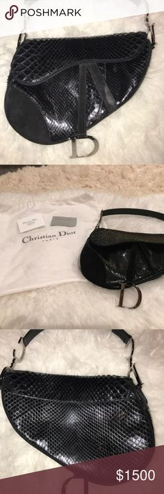 LIMITED EDITION Christian Dior Python Saddle Bag Black genuine python skin saddle bag featuring tonal black suede accents, silver tone hardware and 'C' and 'D' logo pieces. Leather shoulder strap, hidden velcro closure at front flap, interior zip pocket, nylon lining, silver hardware. Very good condition-suede strap shows some signs of wear; hardware shows minor scuffs.  SUPER LIMITED EDITION, designed by John Galliano; was one of only two purses purchased from a luxury department store…