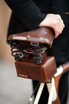 Hand-tooled leather bicycle seat bag by Walnut Design Studio.