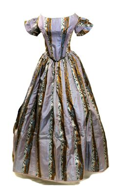 The changeable silk is a purple blue color, and although it seems strange contrasted with copper, blue, and white brocade it comes together as a whole very well. The bodice has the common 1850s waist which is dropped much lower than previous styles and decades.
