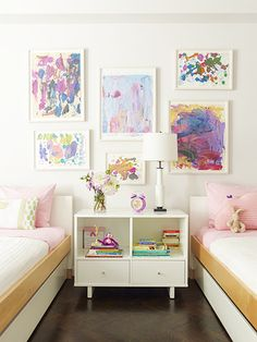 6 Smart Ways To Let Your Child Personalize Their Space // girl's bedroom, gallery wall, kids artwork, white nightstand, white table lamp