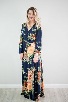"""Floral print maxi dress. Long sleeves. V-neck. Polyester/Spandex blend Model is 5'6"""""""" wearing a small"""