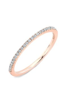 Pavé diamonds add sparkle to this stackable band in rose fold.