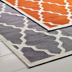 @ orange pattern rug.  would go perfect with green or blue nursery.