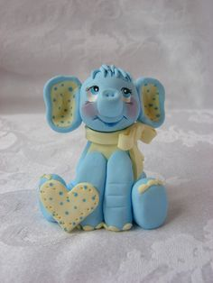 Personalized Elephant Shower/Birthday Cake Topper, Childrens Polymer Clay Christmas Ornament.  A Hand crafted art sculpture.. $14.95, via Etsy.