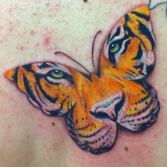 Butterfly tiger face tattoo