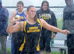 Lauren Hargrave of Louisa-Muscatine throws the shot put during a heavy downpour at Thursday's district track meet in Tipton. The girls shot put was one of just seven events completed before the meet was postponed. (Beth Van Zandt, Muscatine Journal) #qcvarsity #shotput #Louisa-Muscatine #LaurenHargrave #sports