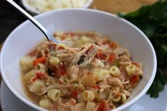 Slow Cooker Sicilian Chicken Soup with a peppery broth, fresh vegetables and tender most chicken.