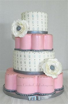 If a cake could describe me, this is very much close to it! I love the petal tiers & the double oval embossing with the smaller oval painted with silver & the peonies with silver centers! It's beautiful!