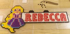 Here is a great Rapunzel Door Sign...  thanks to http://hamabeadpatterns.co.uk