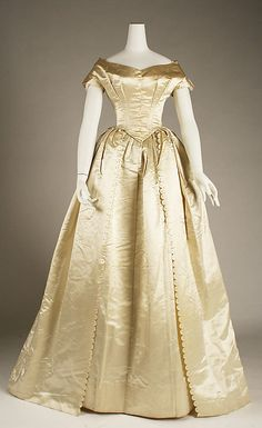 Wedding Ensemble, American, 1831. In addition to the satin dress, the ensemble includes lace bertha and cuffs, floral wreath and net veil, and wrist-length gloves.