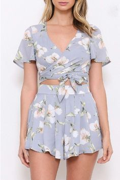 Grayish blue floral printed two piece set.  Top has short sleeves and wraps and ties around the waist.  Shorts zip up the back and are fully lined.  Floral Two Piece by L'atiste. Clothing - Matching Sets North Carolina