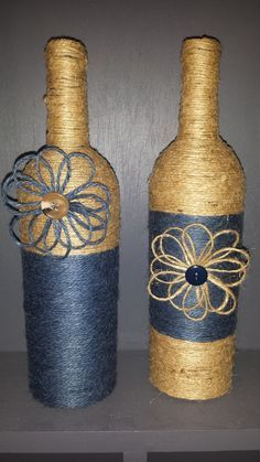 Hand wrapped wine bottles in Blue/Natural jute by ItsaWrapDesigns