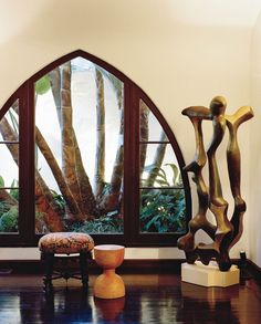 A sculpture by Ernesto Gonzalez Jerrez hovers in the living room.