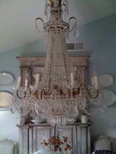 Love this whole look of the Gustavian styling and the massive chandelier. I would like to be invited for tea at this house please...
