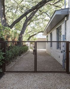 Out of all the cedar fence gate designs out there, this gorgeous, rustic wooden fence is the perfect touch as an entranceway to the garden! Fence gate ideas and design. Front Yard Fence, Pool Fence, Backyard Fences, Fence Gate, Cedar Fence, Bamboo Fence, Horse Fence, Farm Fence, Latice Fence