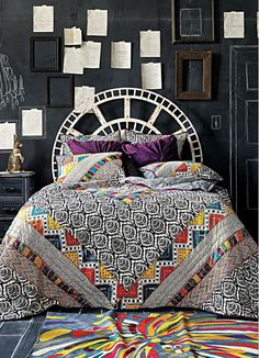 Love the headboard-- you could back it with cork sheets if you wanted it to be a note/message board