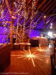 Rich-colored LED uplighting in the background transforms this space.  Vermont wedding at The Round Barn Inn 2012