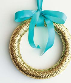 To make this metallic wreath stick a bunch of thumbtacks into a foam wreath base.