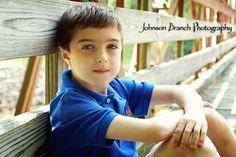 7 year old boy outdoor pose on bridge Johnson Branch Photography