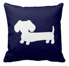 An original doxie design by The Smoothe Store, featuring our wiener dog puppy on a navy blue pillow. Available in a verity of sizes, fabrics and dachshund colors.