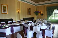 Two Tone Purple Organza Sashes with White Spandex Chair Covers .