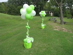 Balloon Topiaries.  Would add streamers hanging down and stick directly in ground.