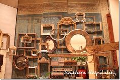 from Rhoda's Southern Hospitality blog - love the blue and gold color scheme in this Anthropologie store display