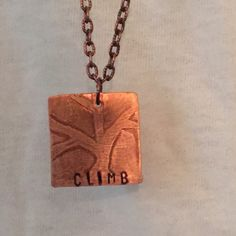 "CLIMB etched copper necklace, handmade FUN! Long copper etched necklace with the inspiring message to CLIMB!  With the hand drawn graphic tree and the hand stamped word, this is a great reminder that can mean something different to each person!  Whether you are a rock climber, or working your way up the corporate ladder, this is for you . Artist initials etched on back side of pendant. Long chain measures 36"" end to end. Toggle clasp. Handmade by VO Jewelry Necklaces"
