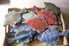 ceramic fish -- I love these flounders!!! auction how about no frame...just a basket full of fish for your coffee table?! Ha!