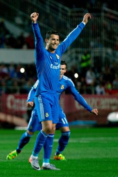 Cristiano Ronaldo celebrates scoring his team's opening goal during the La Liga match between Sevilla FC and Real Madrid CF at Estadio Ramón Sánchez Pizjuán on March 26, 2014 in Seville, Spain.