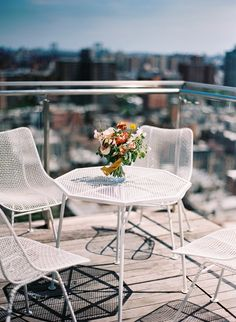 #tablescapes, #table, #city  Photography: Elisa Bricker - elisabricker.com/  Read More: http://www.stylemepretty.com/2015/04/29/intimate-rooftop-new-york-city-wedding/