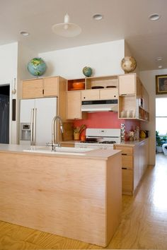 We could keep the red as the back splash and paint the rest white or super pale gray to tone down the red.