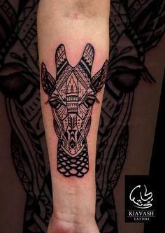 ornamental giraffe tattoo