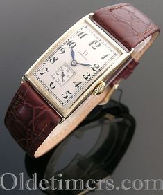 An gold rectangular vintage Omega watch 26 x 37 mm signed Omega, movement is signed Omega, with 15 jewels, silvered dial has black Arabic numerals International Watch Company, Hermes Watch, Time And Tide, Vintage Omega, Watch Companies, This Is Us Quotes, Iwc, Sun Protection, Vintage Watches