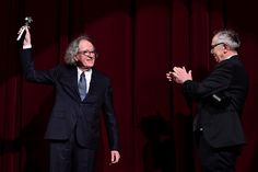 Geoffrey Rush Photos Photos - Australian actor Geoffrey Rush (L) receives the Berlinale Camera award from Berlinale Director Dieter Kosslick at the 67th Berlinale film festival in Berlin on February 11, 2017. / AFP / Tobias SCHWARZ - Geoffrey Rush Receives the Camera Award at the 67th Berlinale Film Festival