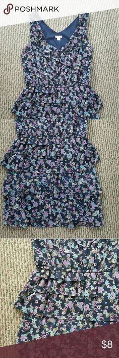 Xhilaration blue floral print dress Xhilaration blue floral print dress. Size large. There are tiers of ruffles and a stretchy waistband. Worn to a few events and in perfect condition. 100% polyester. I have a pet and smoke free home. Xhilaration Dresses