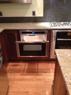 Microwave drawer pull out. Kitchen designed by Kitchen Planners in Rockville, MD.