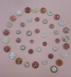 A pretty spiral design with white and pink moonglow buttons and white and colored glass buttons.