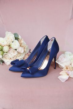 LOOKING FOR something blue? Say 'I do' in the AZELINE navy satin bow court heels.
